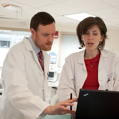 Brent Reed (pharmacy preceptor) and Sarah Hutfilz, PharmD (pharmacy resident)